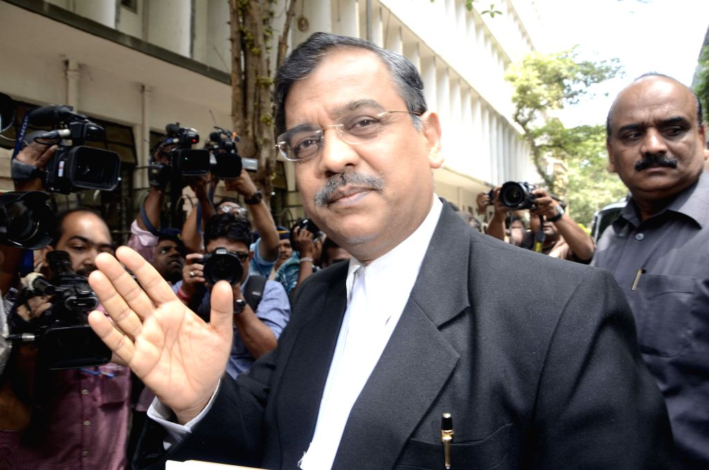 Public Procecuter Ujjwal Nikam arrives at the designated TADA court in Mumbai on May 16, 2013. (Photo: Sandeep Mahankal/IANS)