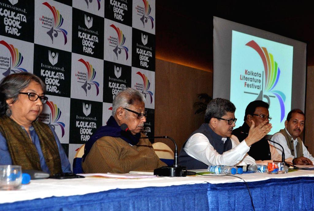 Publishers and Booksellers Guild Secretary Tridib Kumar Chattopadhyay accompanied by the Guild's President Prabir Kumar Mazumdar, Director Sudhangshu Dey and Kolkata Literature Festival ... - Prabir Kumar Mazumdar