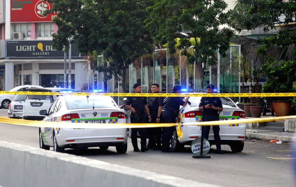 PUCHONG, June 28, 2016 - Policemen stand guard near the explosion site in Puchong, Malaysia, June 28, 2016. At least eight people were injured in the explosion in Puchong early Tuesday. A consular ...