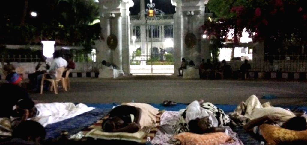 Puducherry Chief Minister V Narayanasamy along with other MLAs sleep outside Lt. Governor Kiran Bedi's official residence in Puducherry on Feb 16, 2019. The 71-one-year old and his ministerial ... - V Narayanasamy and Kiran Bedi