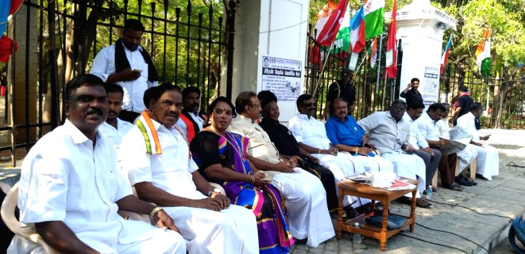 Puducherry: Puducherry Chief Minister V. Narayanasamy and his five ministers during a sit-in protest outside Lt Governor Kiran Bedi's official residence in Puducherry on Feb. 15, 2019. (Photo: IANS/@CMPuducherry) - V. Narayanasamy and Kiran Bedi