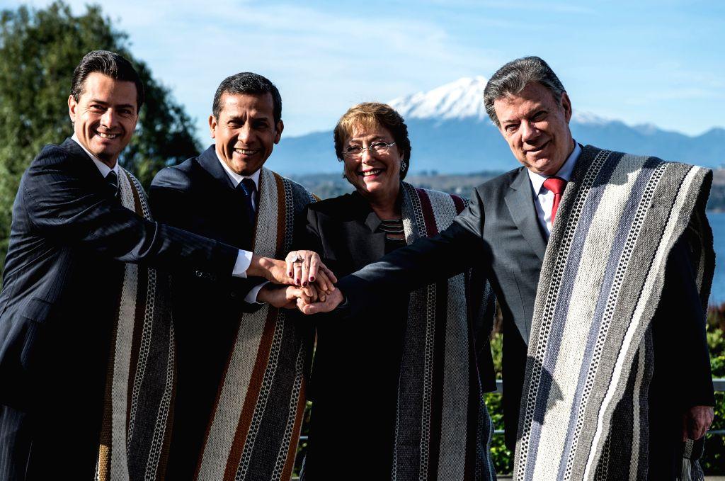 PUERTO VARAS, July 2, 2016 - (L-R) Mexico's President Enrique Pena Nieto, Peru's President Ollanta Humala, Chile's President Michelle Bachelet and Colombia's President Juan Manuel Santos pose for ...