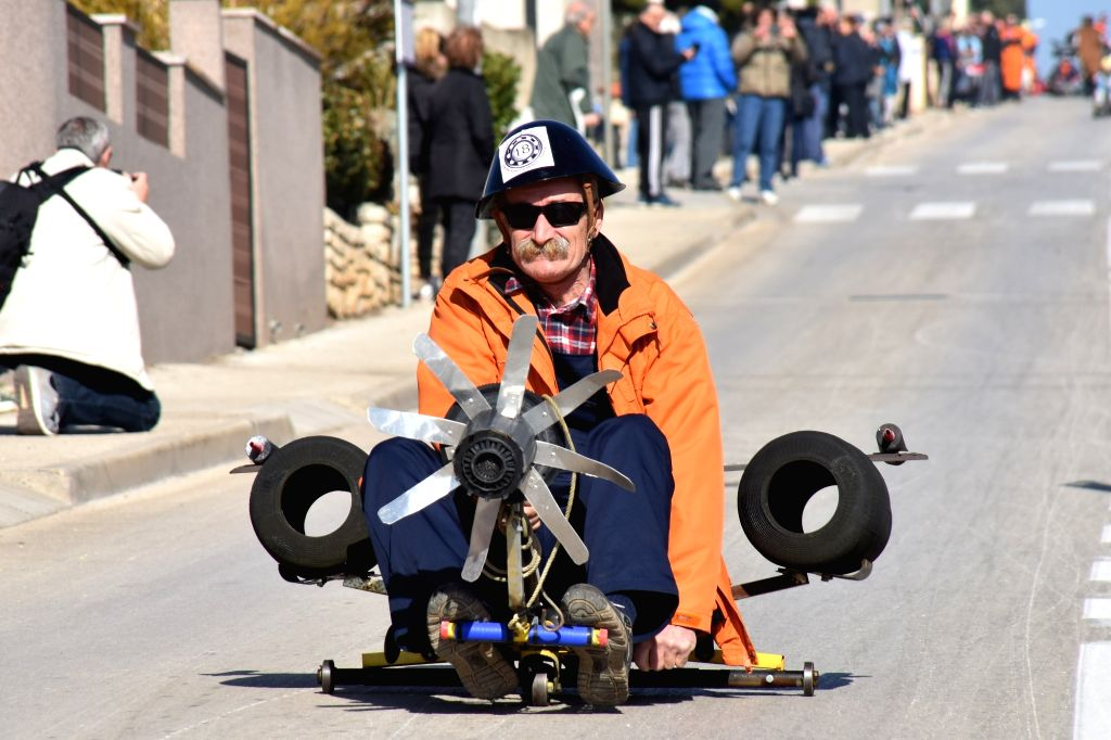 "PULA (CROATIA), Feb. 17, 2019 A man takes part in the ""Balinjerada"" race during a carnival parade in Pula, Croatia, on Feb. 17, 2019."