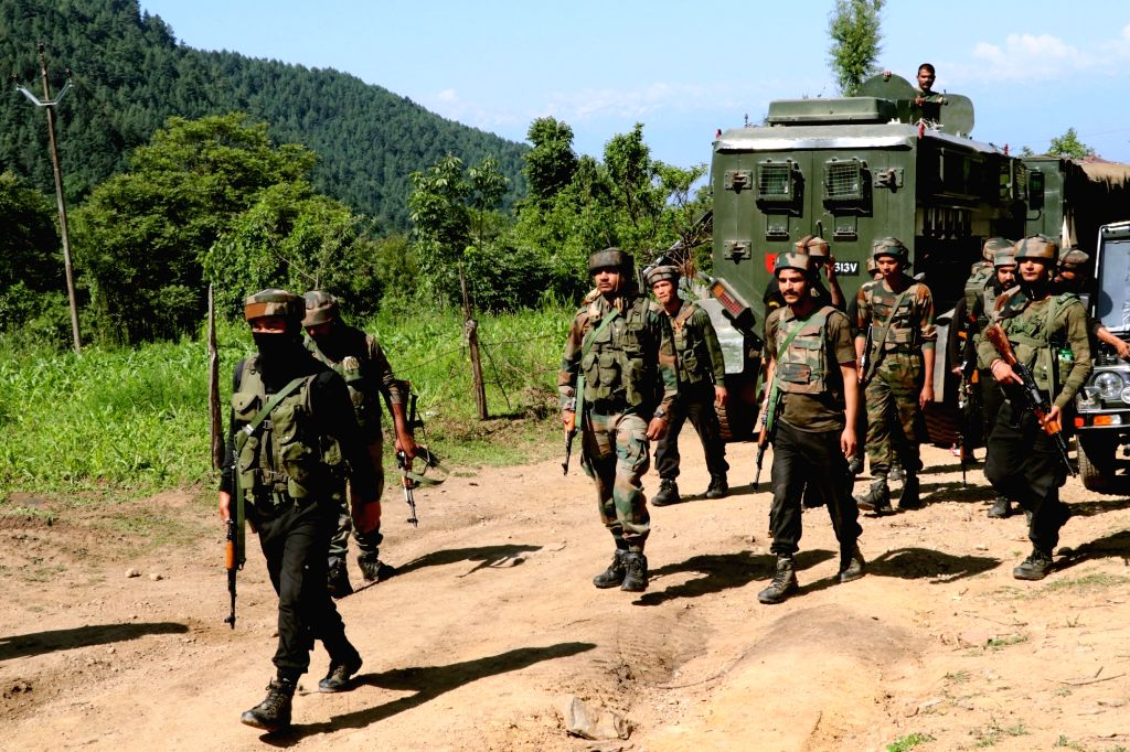 Pulwama: Security forces during a cordon and search operation after a militant was killed in a gunfight in Branpathri forest area of Tral in Jammu and Kashmir's Pulwama district, on June 26, 2019. (Photo: IANS)