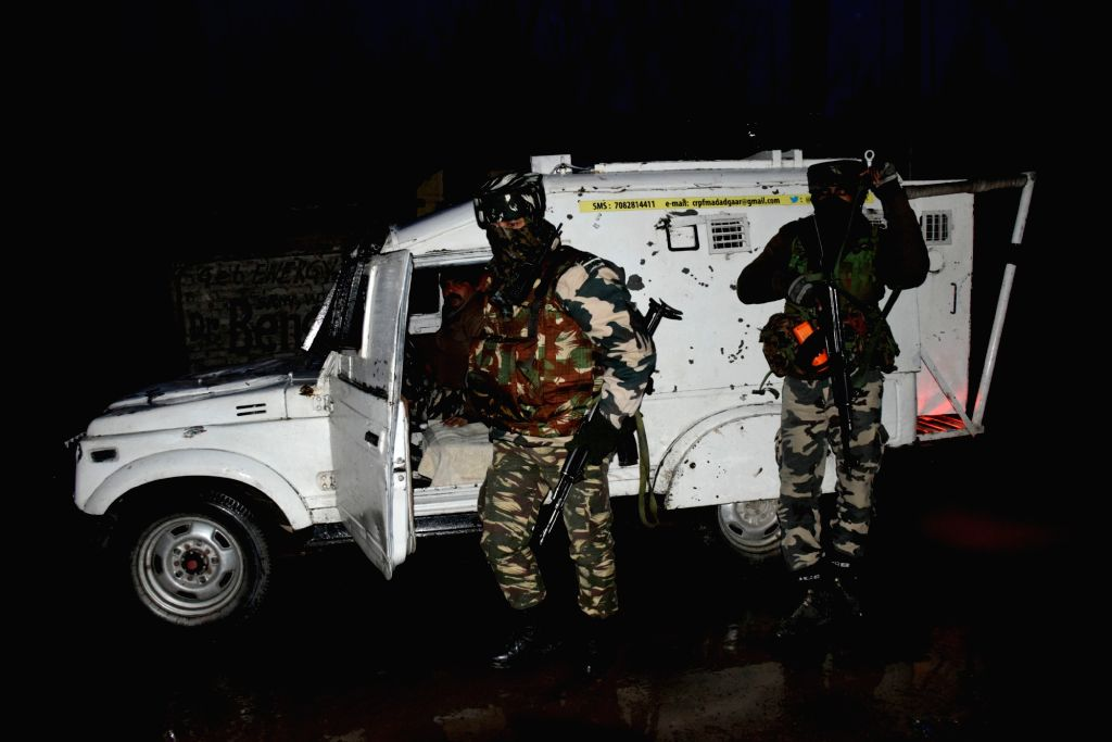 Pulwama: Security personnel during a gunfight with militants in Jammu and Kashmir's Pulwama District on Feb 6, 2019. Police sources said Irfan Ahmad Sheikh, the district commander of LeT, was killed in Chakoora village. (Photo: IANS) - Irfan Ahmad Sheikh