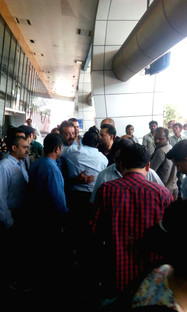 Actor Sanjay Dutt arrives at Pune airport as he heads for Yerawada Central Jail to complete his remaining term after authorities rejected his application to extend his furlough in Pune, on Jan .