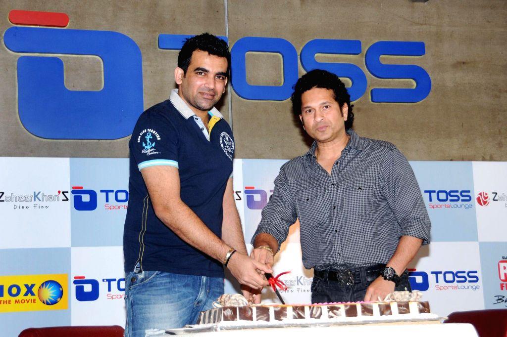 Former cricketer Sachin Tendulkar inaugurate the `Toss Sports Lounge` promoted by cricketer Zaheer Khan at Koregaon Park, Pune on Dec. 13, 2014. - Zaheer Khan