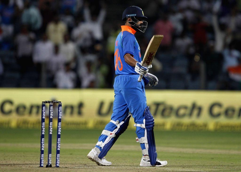 :Pune: India's Virat Kohli celebrates his century during the third ODI (One Day International) match between India and West Indies at Maharashtra Cricket Association Stadium in Pune , on Oct ...