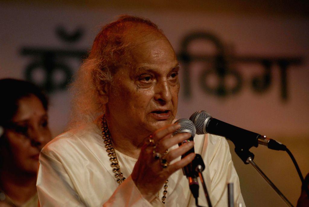 Indian classical vocalist Pandit Jasraj performs during Sawai Gandharva Bhimsen Mahotsav -2014 in Pune on Dec 12, 2014.