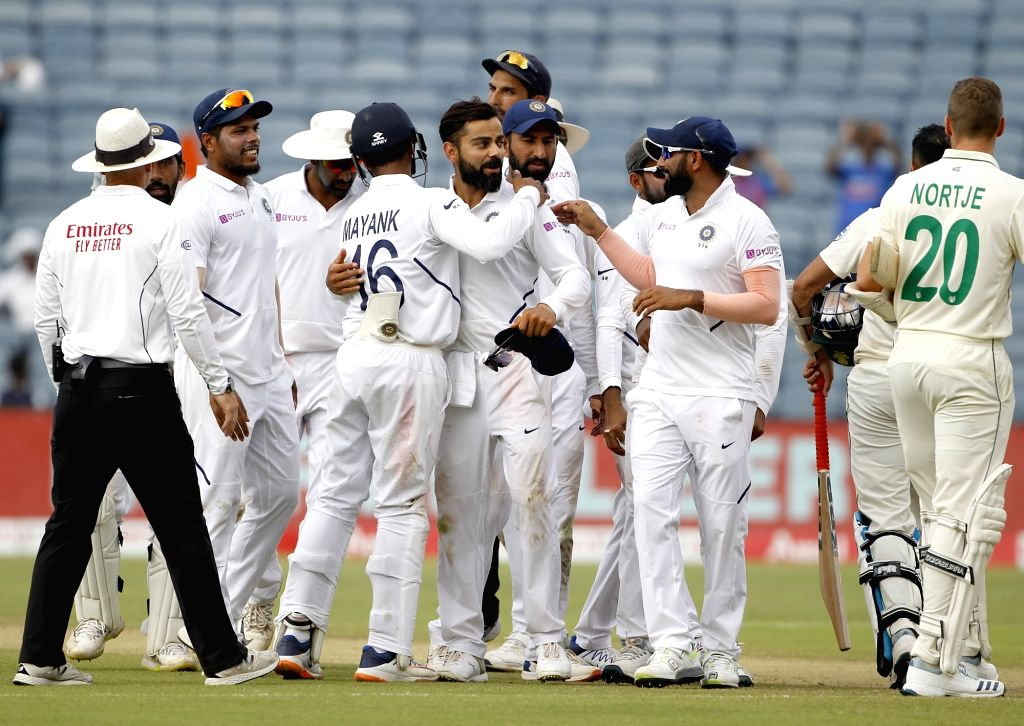 Pune: Indian players celebrate after winning the second Test match against South Africa at Maharashtra Cricket Association Stadium in Pune, on Oct 13, 2019. India won by an innings and 137 runs. (Photo: Surjeet Yadav/IANS) - Surjeet Yadav