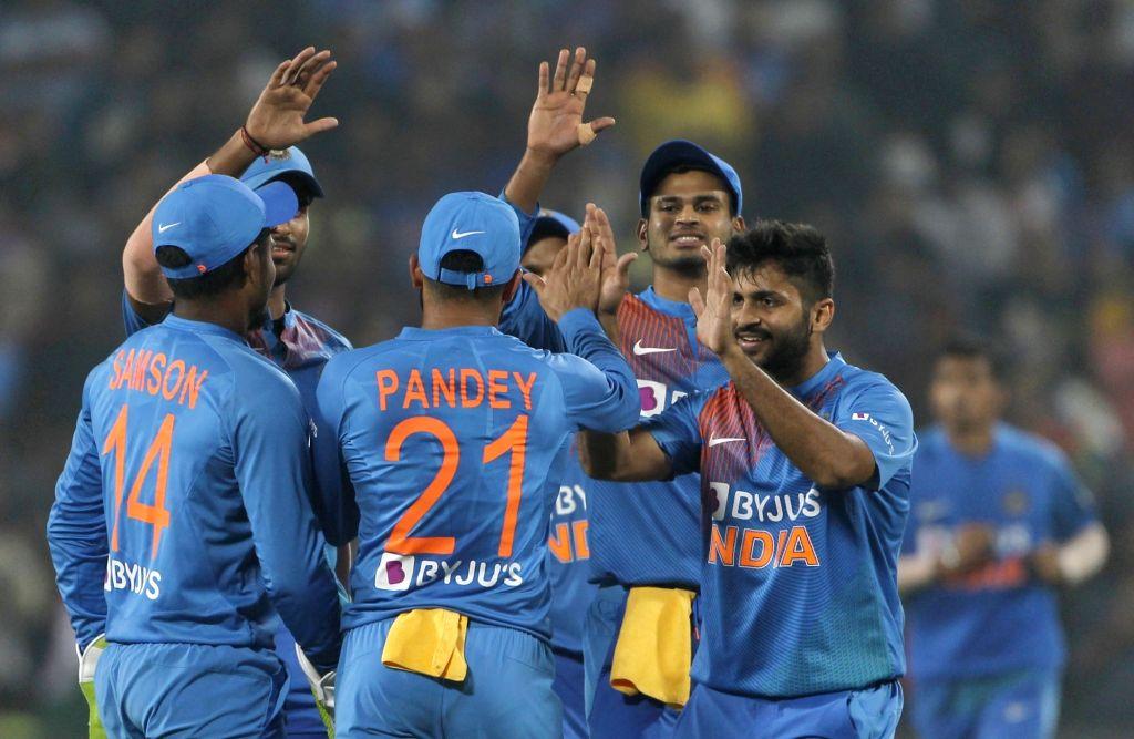 Pune: Indian players celebrate fall of Oshada Fernando's wicket during the 3rd T20I match between India and Sri Lanka at the Maharashtra Cricket Association Stadium in Pune on Jan 10, 2020. (Photo: Surjeet Yadav/IANS) - Surjeet Yadav