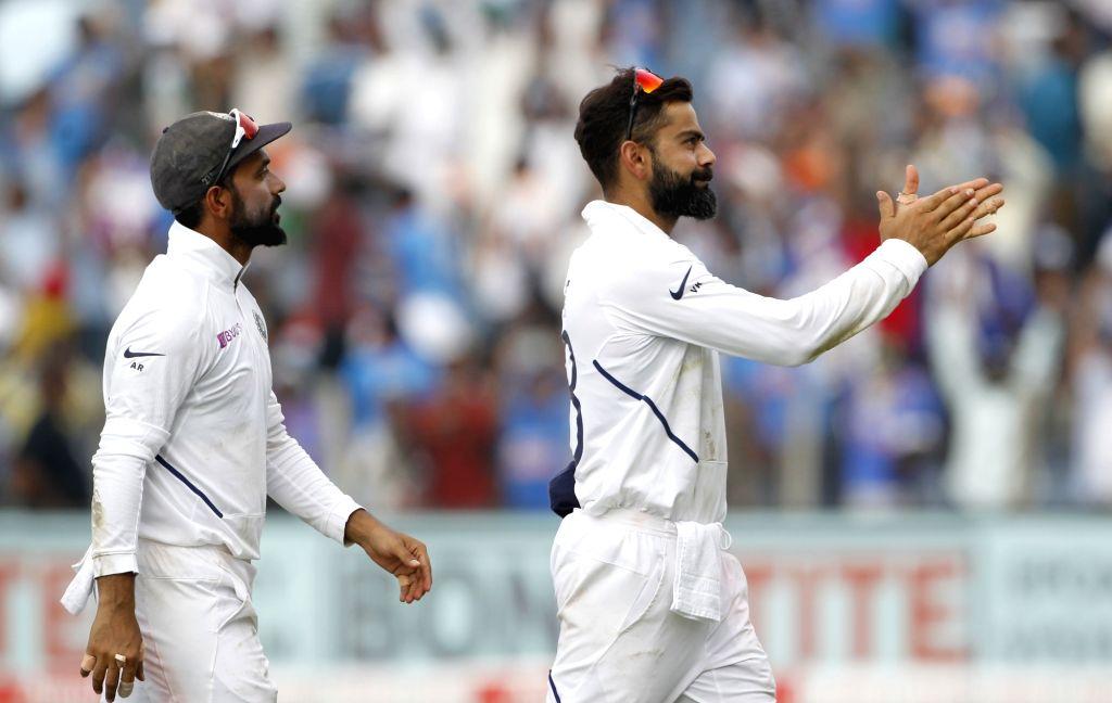 Pune: Indian skipper Virat Kohli celebrates after winning the second Test match against South Africa at Maharashtra Cricket Association Stadium in Pune, on Oct 13, 2019. India won by an innings and 137 runs. (Photo: Surjeet Yadav/IANS) - Virat Kohli and Surjeet Yadav