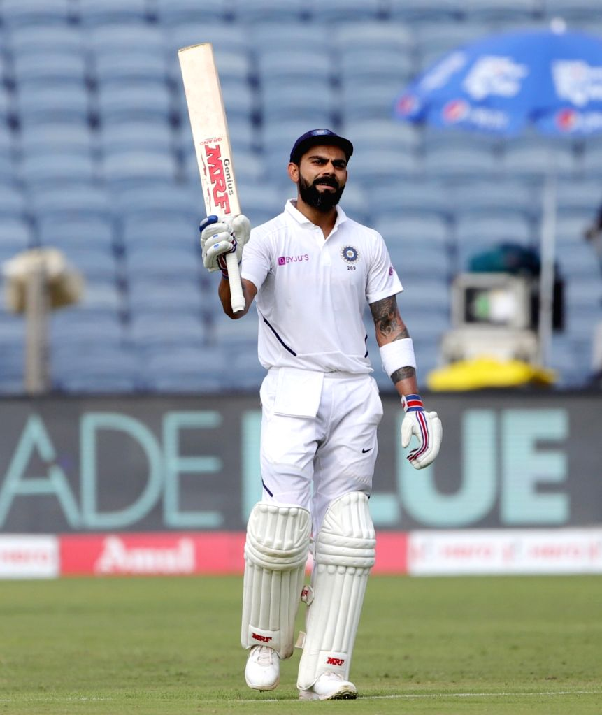 Pune: Indian skipper Virat Kohli celebrates his double century on Day 2 of the second Test match between India and South Africa at Maharashtra Cricket Association Stadium in Pune, on Oct 11, 2019. (Photo: Surjeet Yadav/IANS) - Virat Kohli and Surjeet Yadav