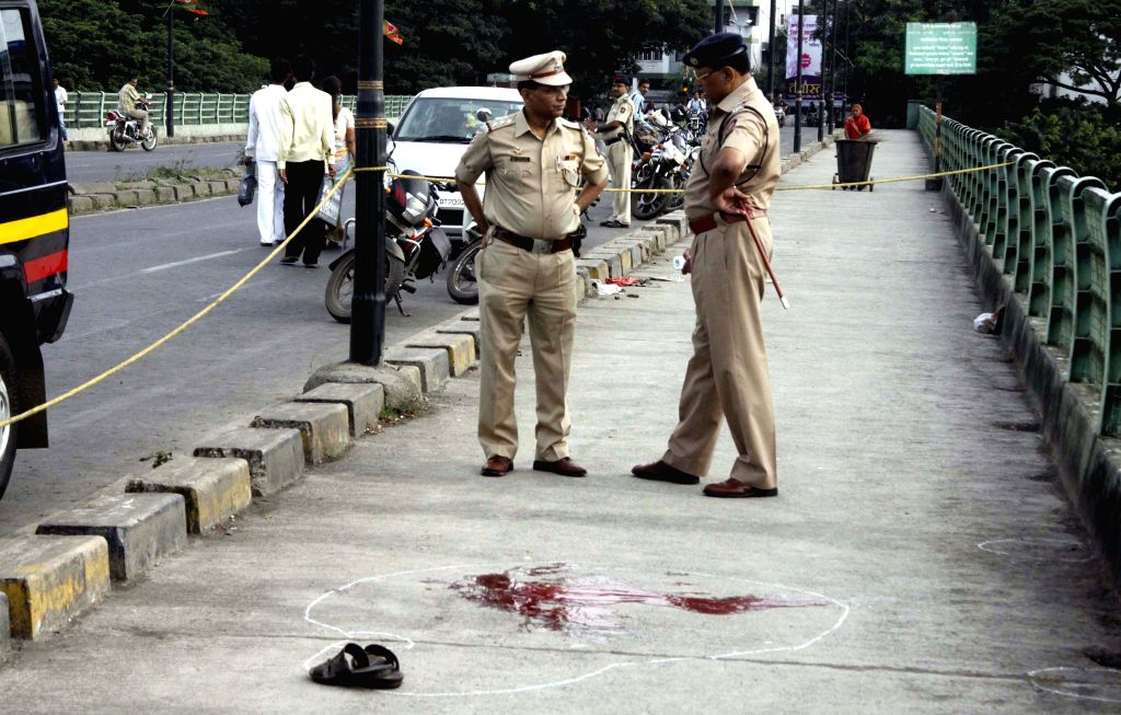 Pune Police investigating the murder of Renowned anti-superstition activist Narendra Dabholkar who was shot dead by two unidentified assailants while he was out on a morning walk in Pune on August 20, 2013. (Photo::: IANS)