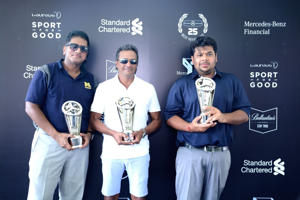 Pune: Winners of National Finals of the Mercedes Trophy 2019 - Golfers Sahil Jain, Murad Talib and Satish Cheeti with their trophies, in Pune on April 5, 2019. The golfers will now represent the country in the World Finals of the MercedesTrophy 2019, - Sahil Jain