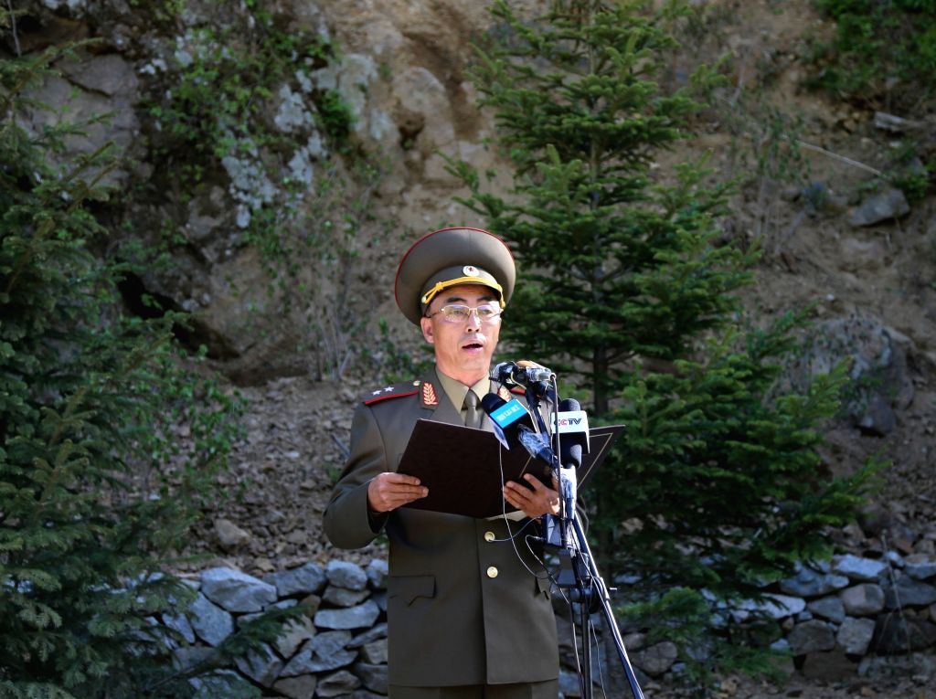 PUNGGYE-RI (DPRK), May 24, 2018 An official of the Nuclear Weapons Institute of the Democratic People's Republic of Korea (DPRK) announces a statement at the nuclear test site of ...