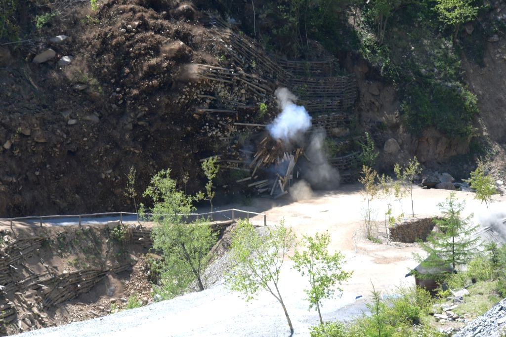 PUNGGYE-RI (DPRK), May 24, 2018 Photo taken on May 24, 2018 shows explosions of the No. 4 tunnel at the nuclear test site of Punggye-ri, the Democratic People's Republic of Korea. The ...