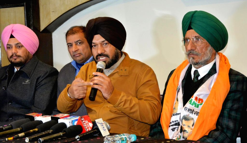 Punjab AAP chief Gurpreet Ghuggi addresses a press conference after SAD president of Amritsar (Urban) Upkar Singh Sandhu joined the party in Amritsar on JAn 14, 2017. - Upkar Singh Sandhu