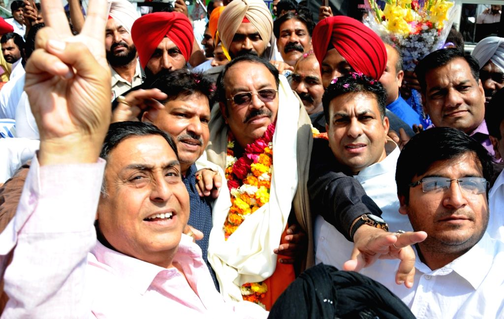 Punjab BJP's new president and Rajya Sabha member Shwet Malik being welcomed by party workers in Amritsar on April 6, 2018. - Malik