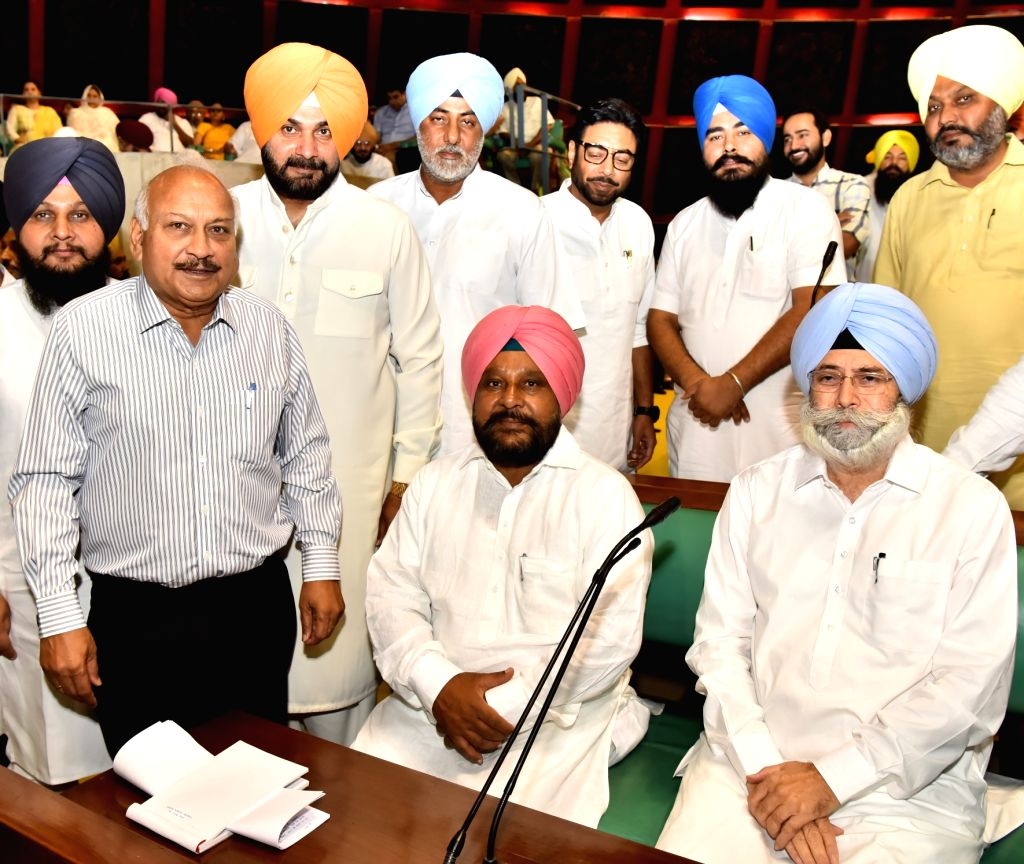 Punjab Cabinet Minister Navjot Singh Sidhu greets Ajaib Singh Bhatti on his elevation as Deputy Speaker of Punjab Assembly in Chandigarh on June 16, 2017. - Navjot Singh Sidhu and Ajaib Singh Bhatti