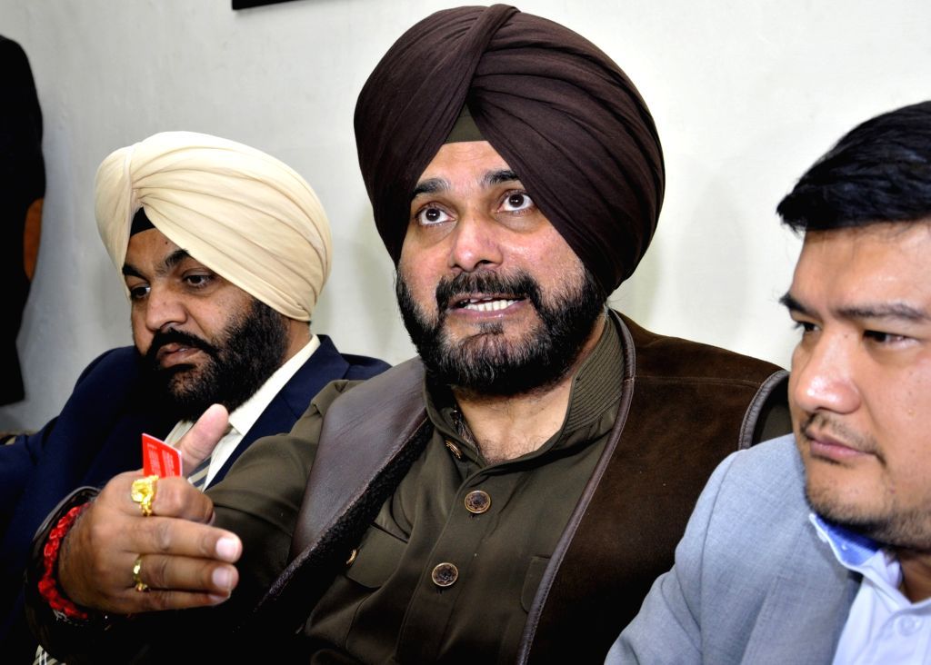 Punjab Cabinet Minister Navjot Singh Sidhu with Congress MP Gurjeet Singh Aujla addresses a press conference in Amritsar on Feb 7, 2018. - Navjot Singh Sidhu and Gurjeet Singh Aujla