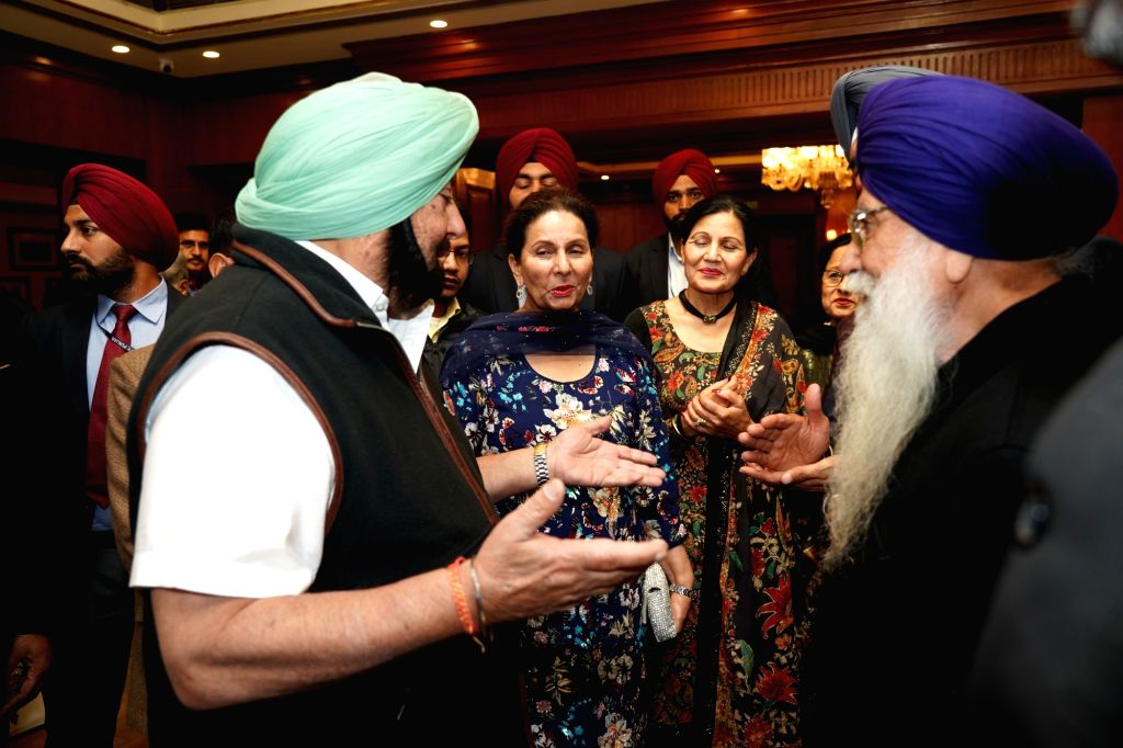 Punjab Chief Minister Amarinder Singh during a meeting with a group of NRIs that came for the 550th birth anniversary celebrations of first Sikh master Guru Nanak Dev in Jalandhar on Nov ... - Amarinder Singh and Nanak Dev