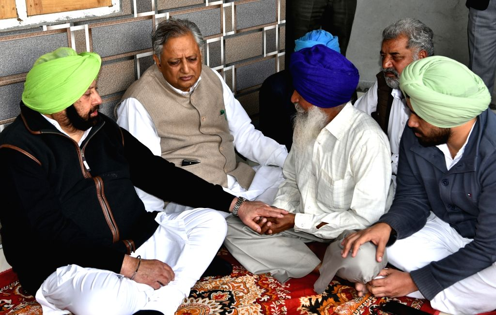 Punjab Chief Minister Amarinder Singh visits bereaved family members of Kulwinder Singh, one of the 49 CRPF personnel killed in a suicide attack by militants in Jammu and Kashmir's Pulwama ... - Amarinder Singh and Kulwinder Singh