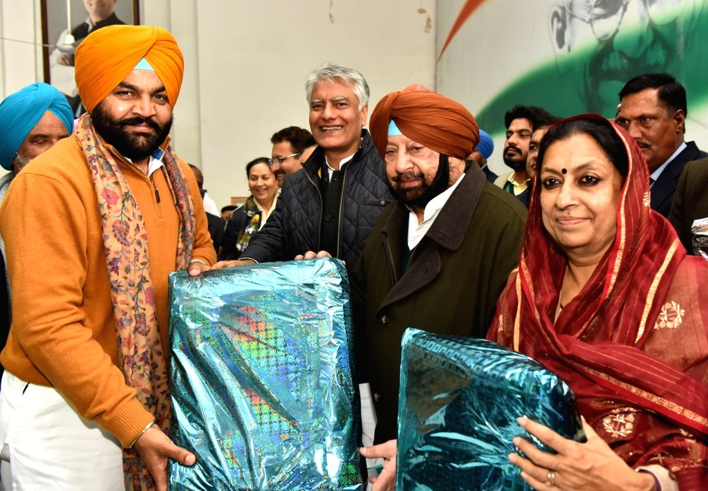 Punjab Chief Minister and Congress leader Amarinder Singh, party's state in-charge Asha Kumari and party state chief Sunil Jakhar at the launch of Congress' 'Jan Sampark Abhiyan' in ... - Amarinder Singh