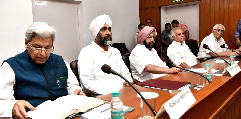 "Punjab Chief Minister Capt Amarinder Singh and Jairam Ramesh's during a programme organised to release Ramesh's book ""Intertwined Lives: PN Haksar and Indira Gandhi"" in ... - Capt Amarinder Singh and Indira Gandhi"
