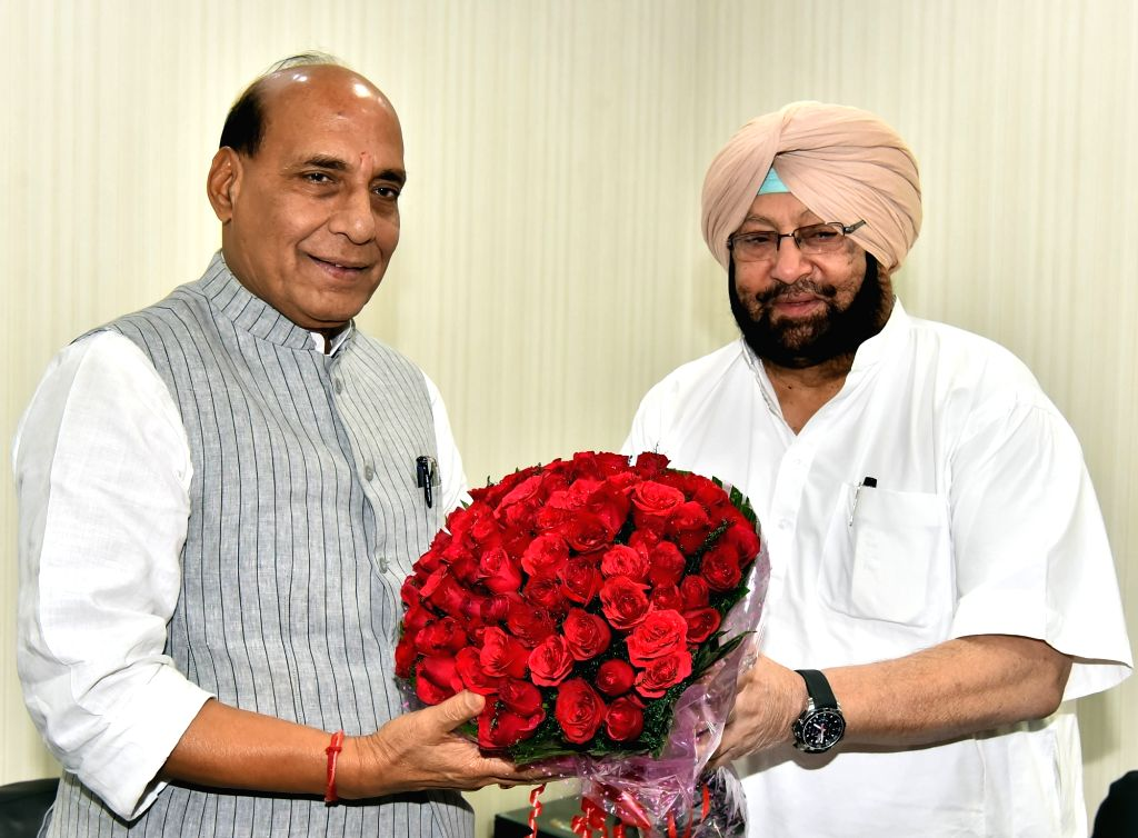 Punjab Chief Minister Capt Amarinder Singh calls on Union Home Minister Rajnath Singh at latter's residence in New Delhi on April 22, 2017. - Capt Amarinder Singh and Rajnath Singh