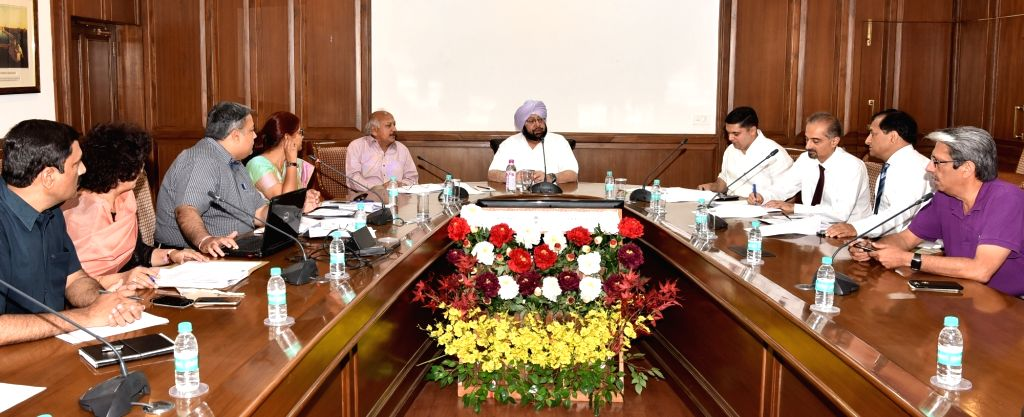 Punjab Chief Minister Captain Amarinder Singh presides over a meeting to review the functioning of government and private medical colleges in Chandigarh on April 26, 2017. - Captain Amarinder Singh