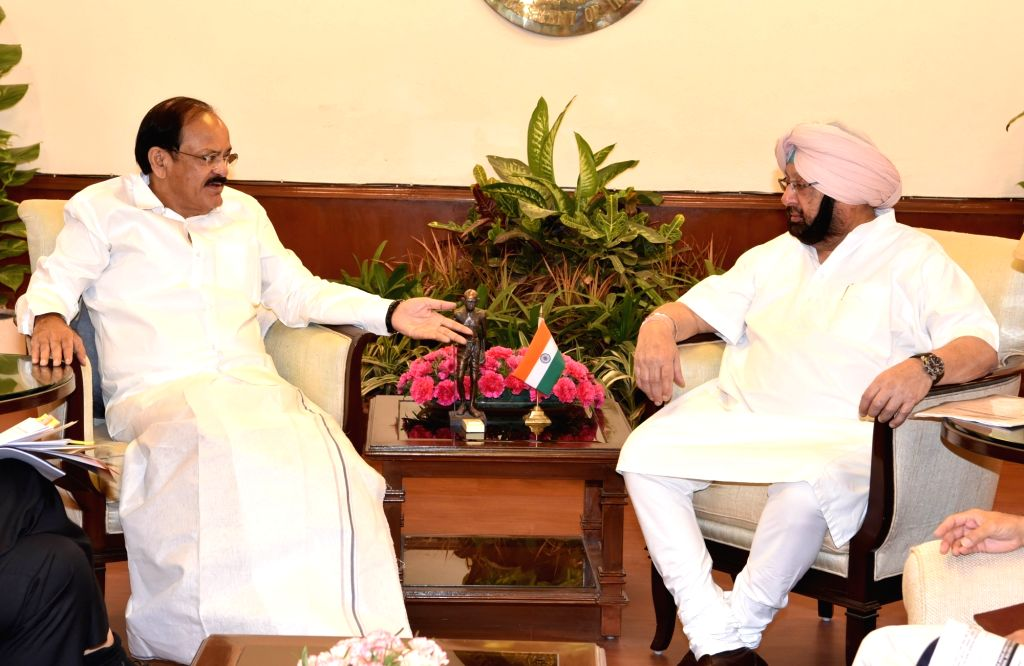 Punjab Chief Minister Captain Amarinder Singh calls on Union Minister M Venkaiah Naidu in New Delhi, on May 17, 2017. - Captain Amarinder Singh and M Venkaiah Naidu