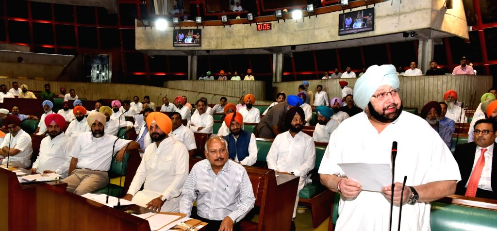 Punjab Chief Minister Captain Amarinder Singh felicitate Ajaib Aingh Bhatti on his elevation as Deputy Speaker of Punjab Assembly in Chandigarh on June 16, 2017. - Captain Amarinder Singh