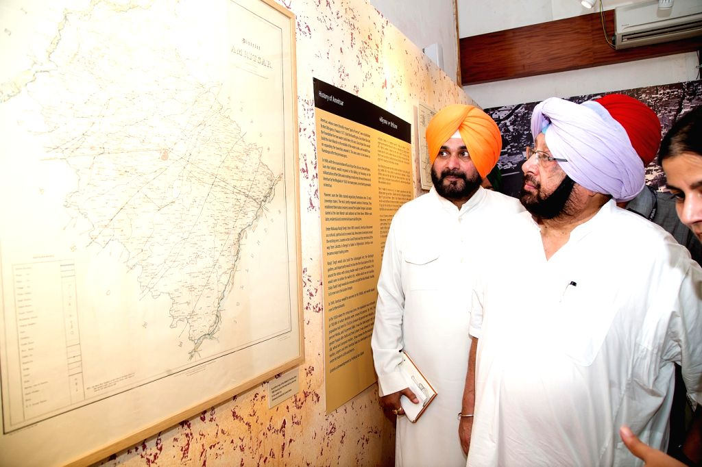 Punjab Chief Minister Captain Amarinder Singh, Punjab Tourism Minister Navjot Singh Sidhu visits the newly inaugurated Partition Museum in Amritsar on Aug 17, 2017. - Captain Amarinder Singh and Navjot Singh Sidhu