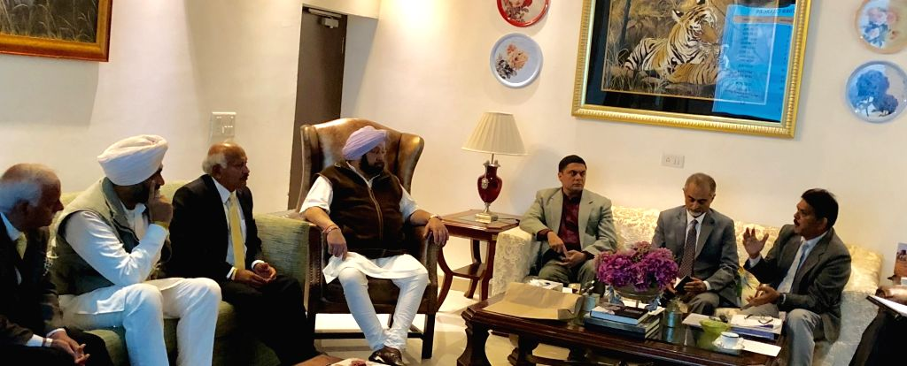 Punjab Chief Minister Captain Amarinder Singh with Health Minister Brahm Mohindra and Finance Minister Manpreet Singh Badal and other officials chairs a meeting of the Cabinet ... - Captain Amarinder Singh and Manpreet Singh Badal