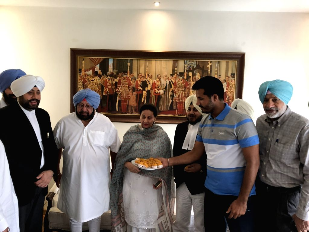 Punjab Chief Minister Captain Amarinder Singh celebrates with wife Preneet Kaur and his lawyers after the Mohali court accepts the Vigilance Bureau's cancellation report in the Amritsar ... - Captain Amarinder Singh and Preneet Kaur