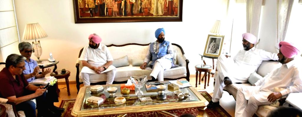 Punjab Chief Minister Captain Amarinder Singh chairs a high-level meeting regarding a new Sports University to be set up at Patiala, at his official residence in Chandigarh on June 1, 2019. - Captain Amarinder Singh