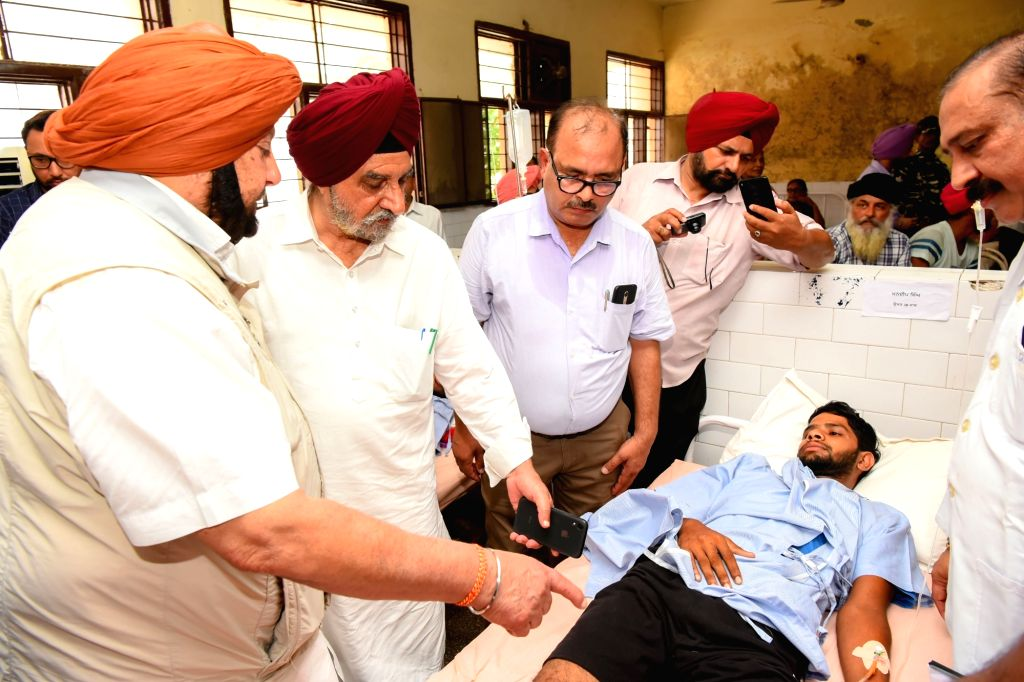 Punjab Chief Minister Captain Amarinder Singh mmets one of the victims of   Gurdaspur factory blast undergoing treatment at the Civil Hospital in Batala, on Sep 6, 2019. - Captain Amarinder Singh