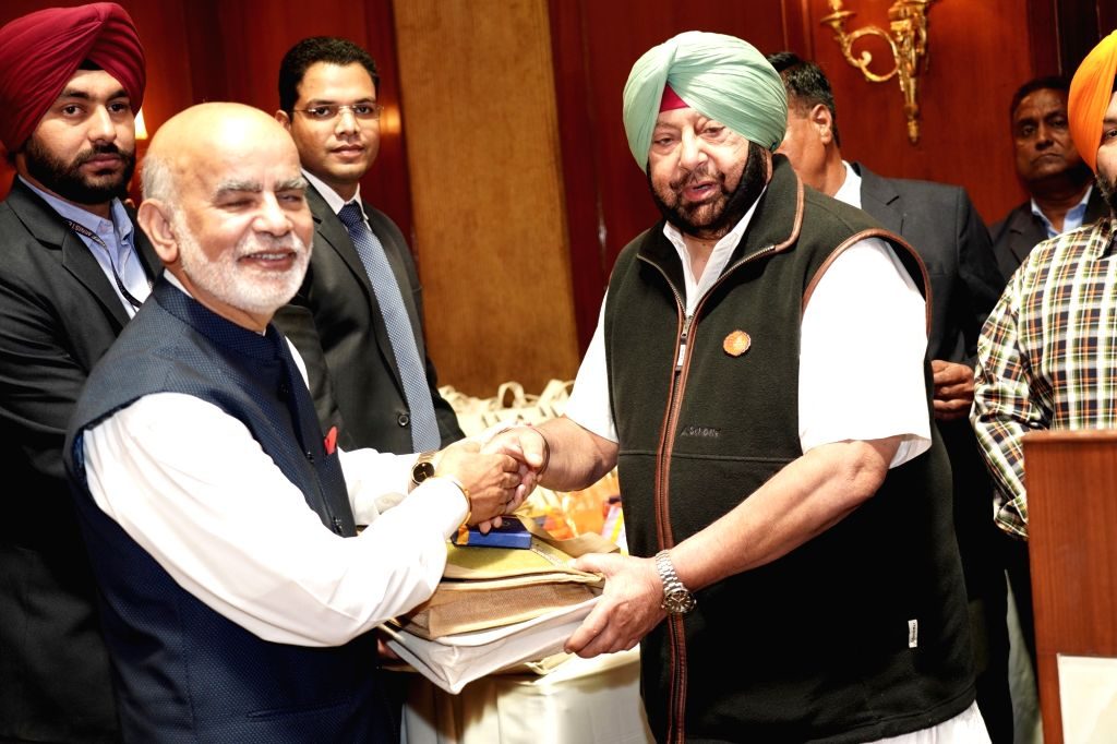 Punjab Chief Minister Captain Amarinder Singh welcomes Member Parliament from UK Lord Diljit Rana who came for the 550th birth anniversary celebrations of first Sikh master Guru Nanak Dev ... - Captain Amarinder Singh and Nanak Dev