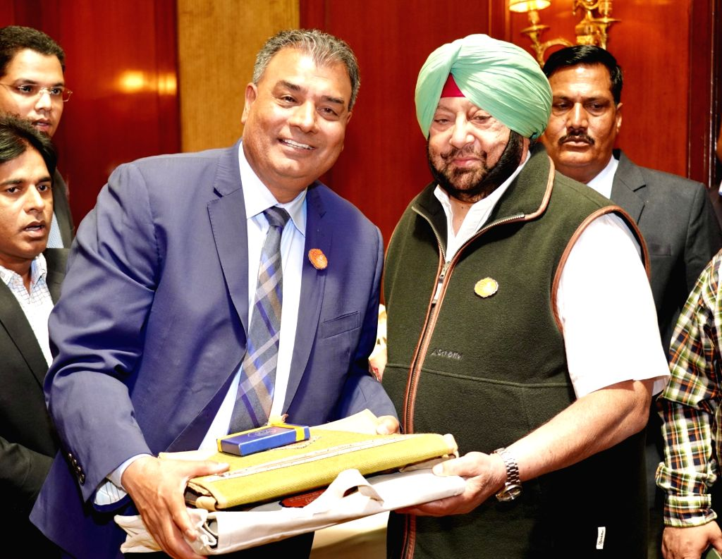Punjab Chief Minister Captain Amarinder Singh welcomes Member of Parliament from Canada Bob Saroya who came for the 550th birth anniversary celebrations of first Sikh master Guru Nanak Dev ... - Captain Amarinder Singh and Nanak Dev