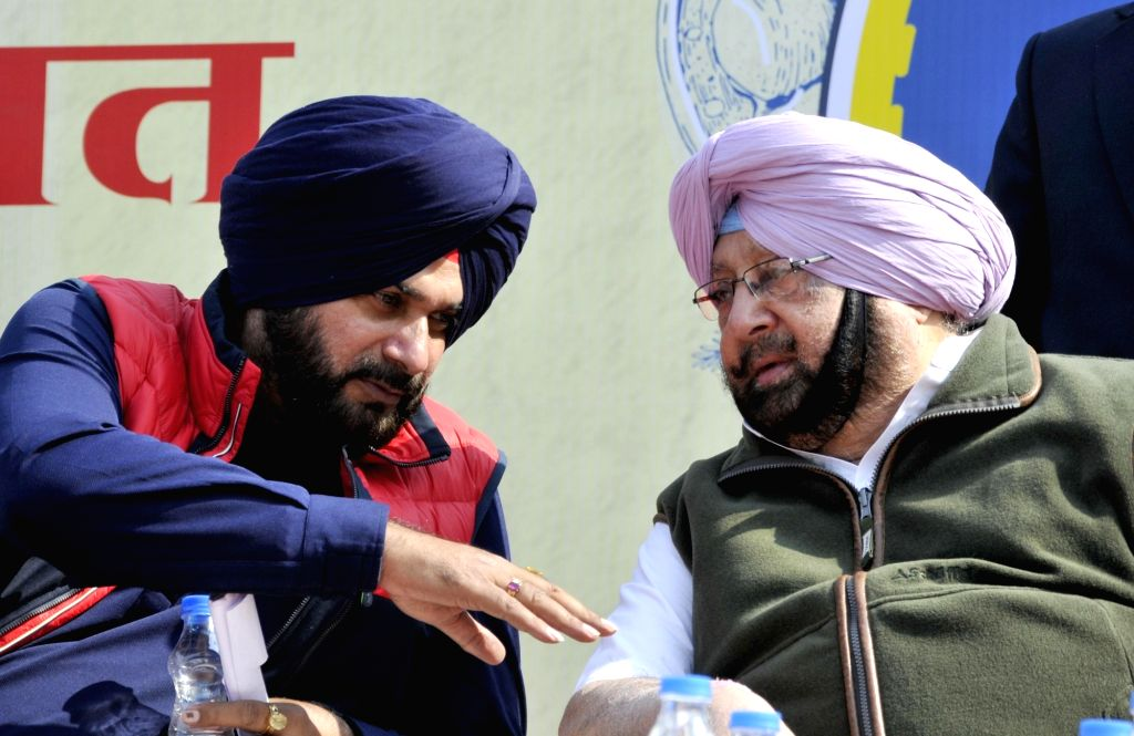 Punjab Chief Minister Captain Amarinder Singh and the state's Cabinet Minister Navjot Singh Sidhu. (Photo: IANS) - Captain Amarinder Singh and Navjot Singh Sidhu