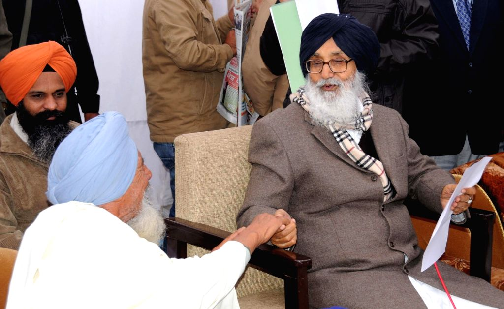 Punjab Chief Minister Parkash Singh Badal interacts with people during a Programme at Lambi, in Muktsar on Dec.20, 2013.