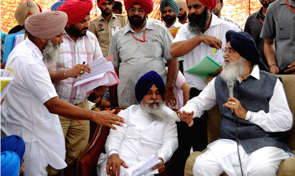 Punjab Chief Minister Parkash Singh Badal interacts with people at a programme at Lambi in Muktsar on August 2, 2014.