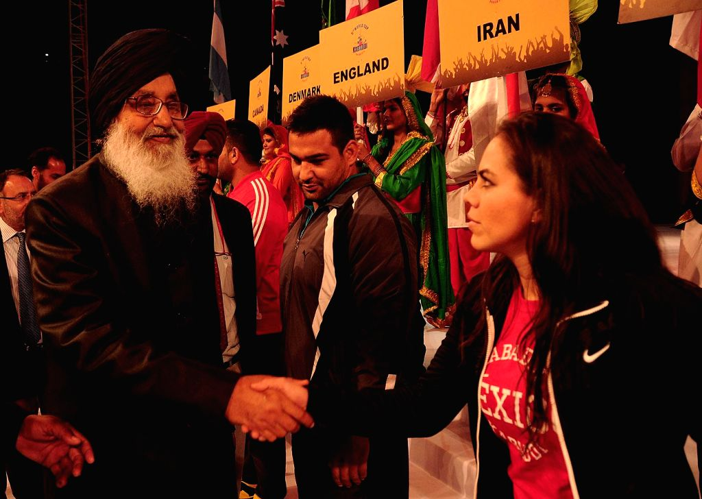 Punjab Chief Minister Parkash Singh Badal interacting with the captains of the Kabbadi team during the inaugural programme of fifth World Kabbadi Cup in Amritsar on Dec 6, 2014. - Parkash Singh Badal
