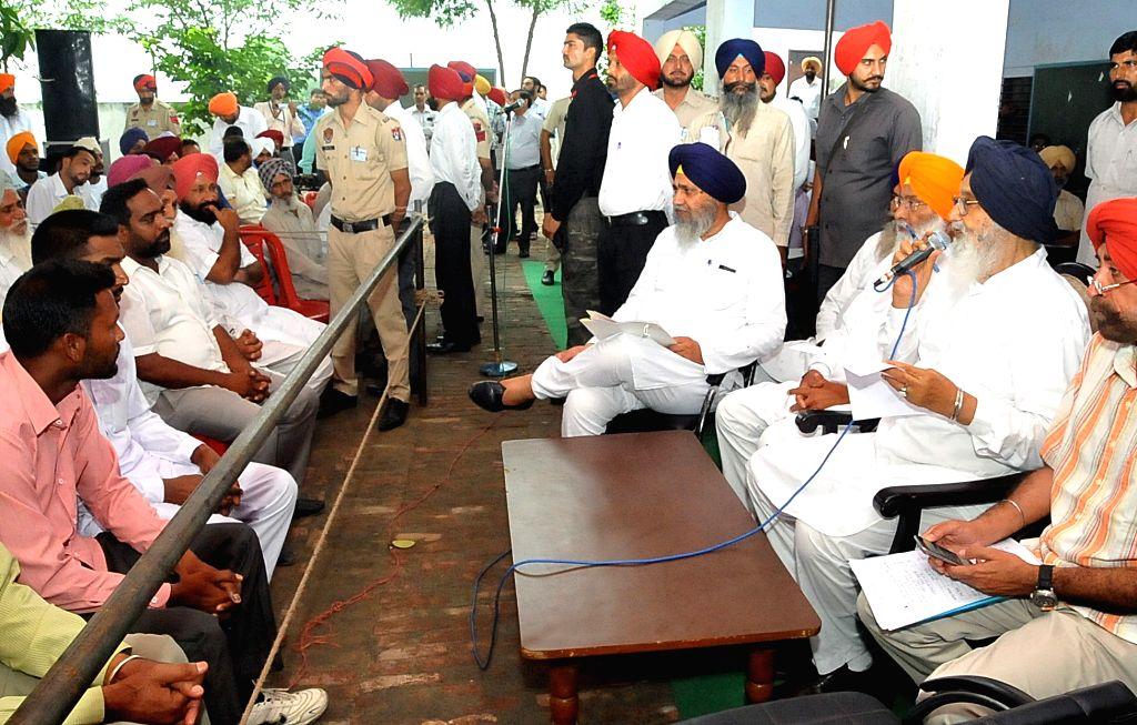 Punjab Chief Minister Parkash Singh Badal interacts with people during a programme organised at Dhuri village in Sangrur, Punjab on June 25, 2015. - Parkash Singh Badal