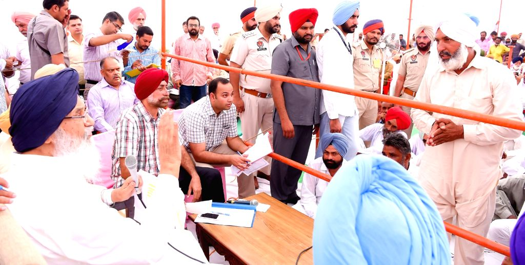 Punjab Chief Minister Parkash Singh Badal interacts with people during a Sangat Darshan programme in Muktsar of Punjab on Sept 26, 2016. - Parkash Singh Badal