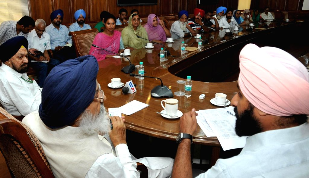 Punjab Chief Minister Parkash Singh Badal and Punjab Revenue Minister Bikram Singh Majithia interact with the relatives of Indians rapped in violence hit Iraq, at Punjab Bhawan in Chandigarh on July . - Parkash Singh Badal and Bikram Singh Majithia