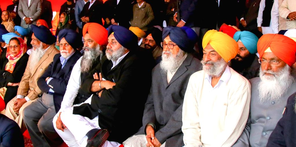 Punjab Chief Minister Parkash Singh Badal and Deputy Chief Minister Sukhbir Singh Badal during a Shiromani Akali Dal rally in Muktsar on Jan 14, 2016. - Parkash Singh Badal and Sukhbir Singh Badal