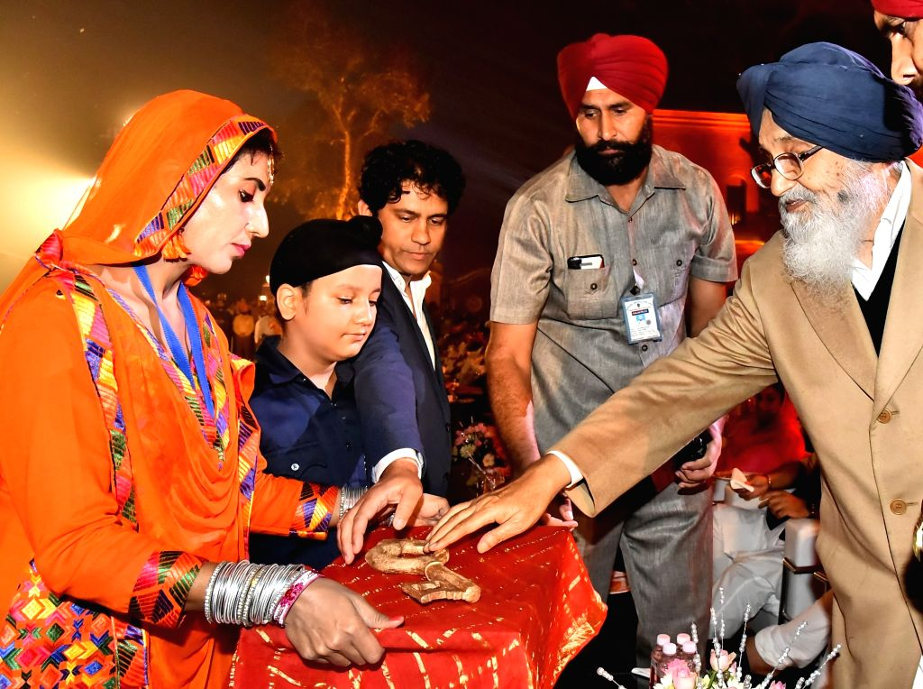 Punjab Chief Minister Parkash Singh Badal and Deputy Chief Minister Sukhbir Singh Badal honor prominent personalities during semi-centennial celebrations of Punjabi Suba in Amritsar on Nov ... - Parkash Singh Badal and Sukhbir Singh Badal