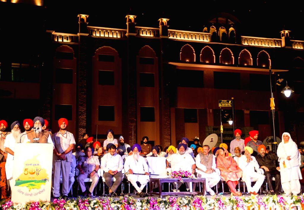 Punjab Chief Minister Parkash Singh Badal, Deputy Chief Minister Sukhbir Singh Badal and Union Ministers Harsimrat Kaur Badal during a programme dedicate for the Amritsar Beautification ... - Parkash Singh Badal, Harsimrat Kaur Badal and Sukhbir Singh Badal